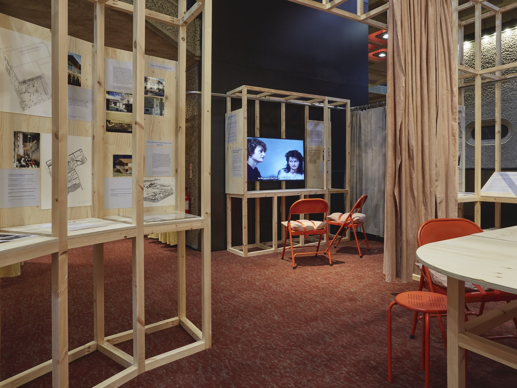 An installation view of Heather Powell, Paradise Circus, produced with Birmingham Film and Video Workshop, at the Barbican exhibition by Matrix, 'How We Live Now'. Photograph © Thomas Adank